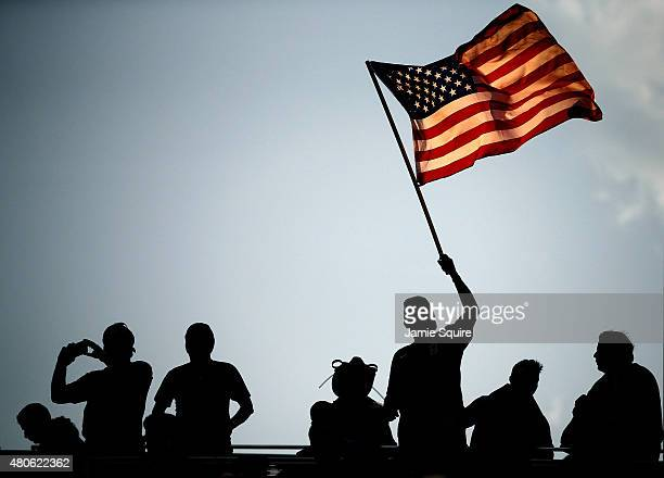 A fan waves an American flag prior to the start of the CONCACAF Gold Cup match between Panama and the United States at Sporting Park on July 13 2015...