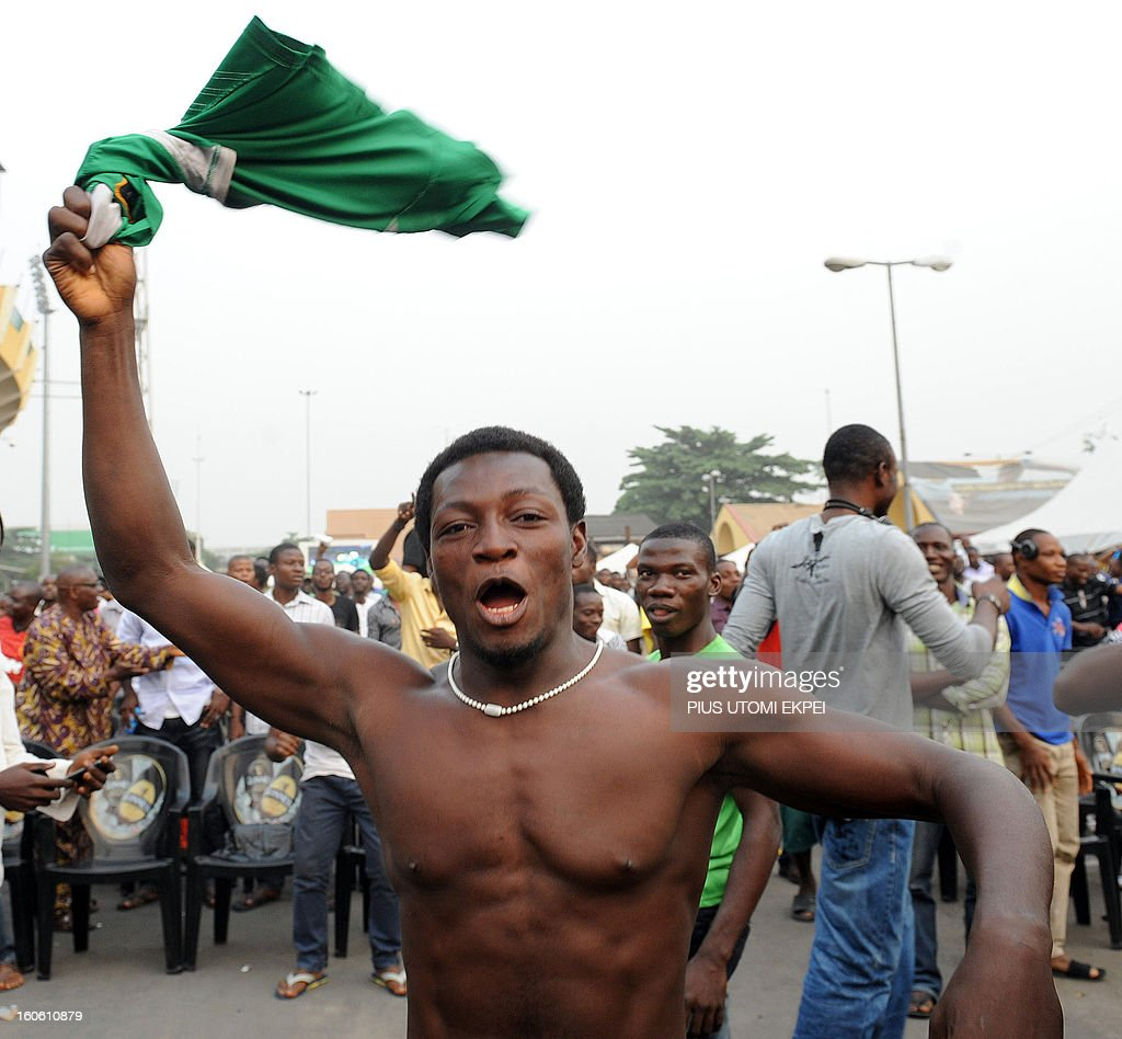 A fan waves his T-shirt to celebrate Nigeria football team's victory over Ivory Coast to advance into the semi final of the 2013 African Cup of Nations on February 3, 2013 at a public viewing centre in Lagos. Supposed underdogs Nigeria downed favourites Ivory Coast 2-1 in an absorbing quarter-final to set up a last-four meeting with Mali.