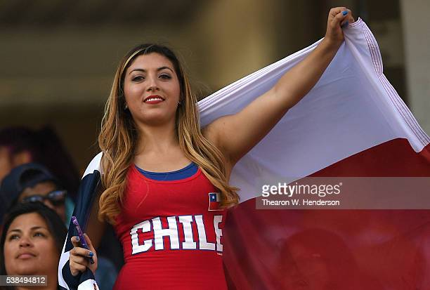 A fan waves the Chile flag prior to the start of the game during the 2016 Copa America Centenario Group match play between Argentina and Chile at...