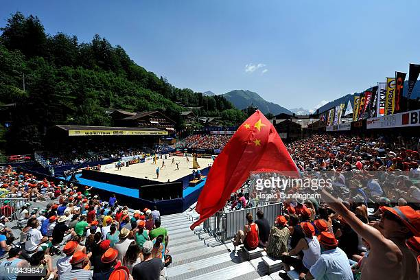 A fan waves the Chinese flag during the LiliSeixas v XueZhang Xi final match as part of the FIVB Gstaad Grand Slam sixth day on July 14 2013 in...