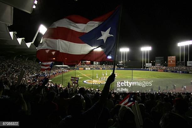 A fan waves the Puerto Rican flag before the game against Cuba at the World Baseball Classic at Hiram Bithorn Stadium on March 10 2006 in San Juan...