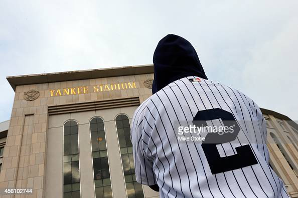 A fan wearing a Derek Jeter jersey stands outside of Yankee Stadium prior to his last game there on September 25 2014 the Bronx borough of New York...