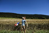 A fan wearing a fake head of horse cheers along the road with a French national flag during the 160 km fifteenth stage of the 103rd edition of the...