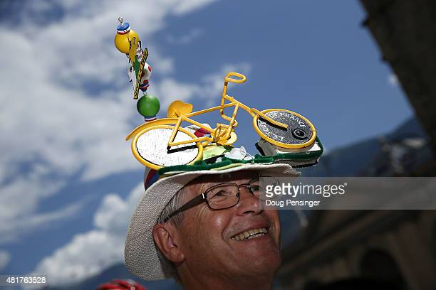 A fan wearing a modified hat attends the start Stage 19 of the 2015 Tour de France a 138km stage between SaintJeandeMaurienne and La Toussuire on...