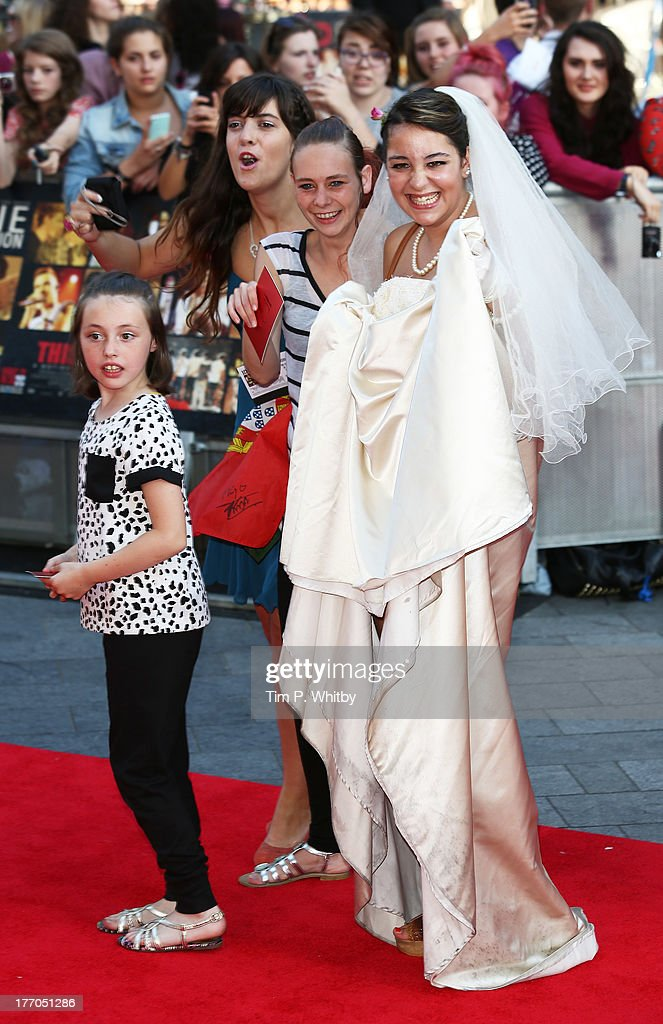 A fan wearing a wedding dress attends the World Premiere of 'One Direction: This Is Us' at Empire Leicester Square on August 20, 2013 in London, England.