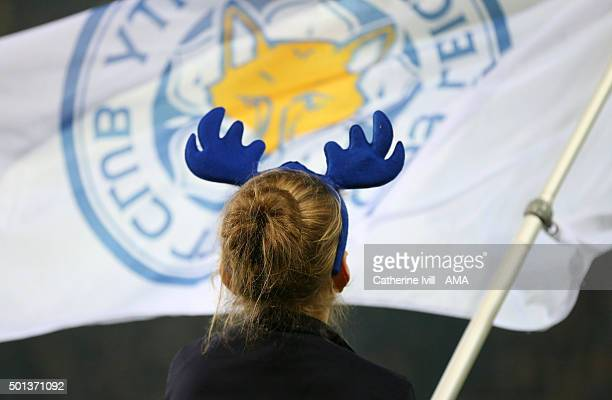 A fan wearing Christmas reindeer antlers in front of a Leicester City flag before the Barclays Premier League match between Leicester City and...