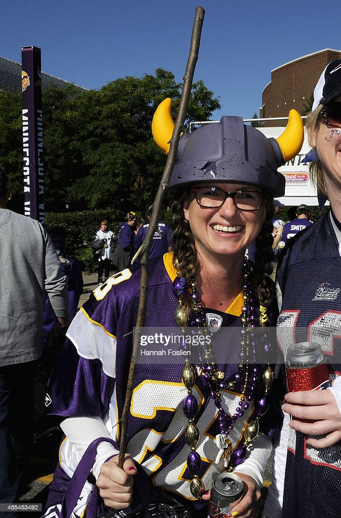 A fan wearing the jersey of Adrian Peterson of the Minnesota Vikings carrying a switch poses for a portrait while tailgating before the game between...