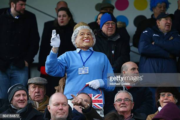 A fan wearing the Queen Elizabeth mask is seen prior to the Emirates FA Cup third round match between Eastleigh and Bolton Wanderers at Silverlake...