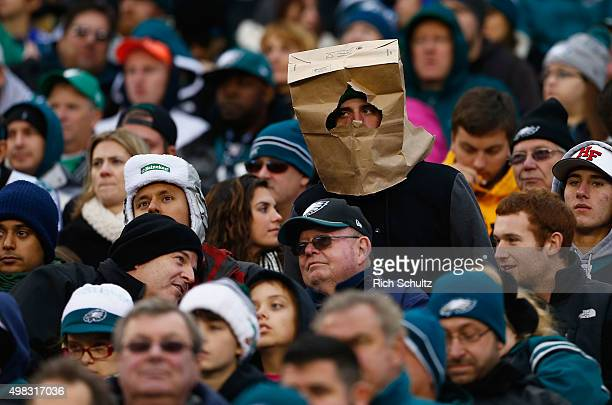 A fan wears a bag over his head as he watches the game between the Philadelphia Eagles and the Tampa Bay Buccaneers at Lincoln Financial Field on...