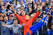 A fan wears a Justin Rose face mask prior to the Singles Matches of the 2014 Ryder Cup on the PGA Centenary course at the Gleneagles Hotel on...