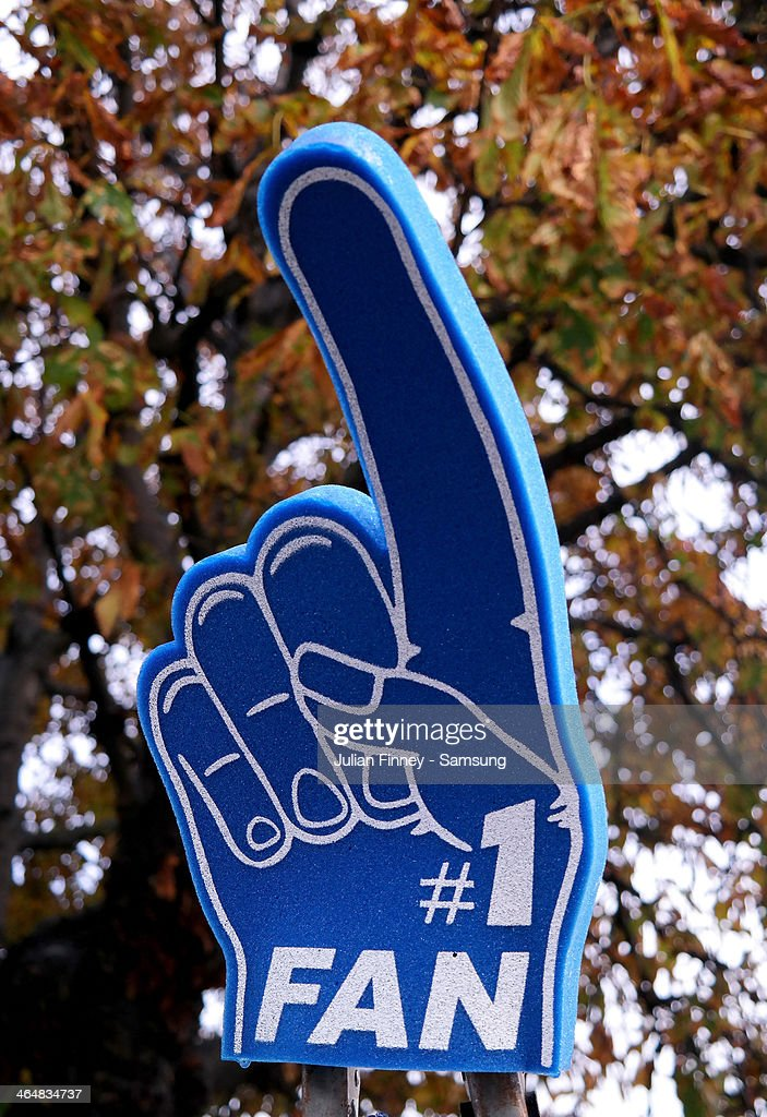 A fan wears a large sponge hand with 'No. 1 fan' on it during the Barclays Premier League match between Chelsea and West Bromwich Albion at Stamford Bridge on November 9, 2013 in London, England.