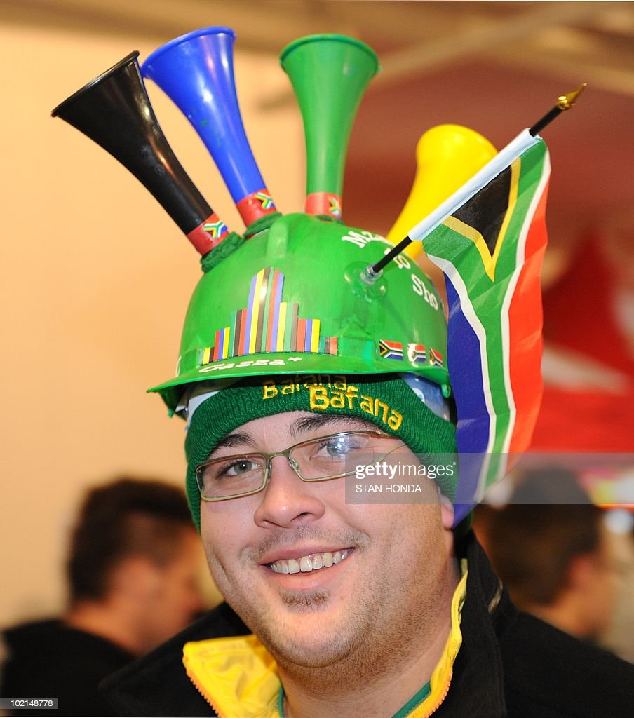 A fan wears a makarapa before watching the South Africa-Uruguay game at the Silverstar Casino in Muldersdrift on June 16, 2010 during the 2010 World Cup football tournament. AFP PHOTO/Stan Honda