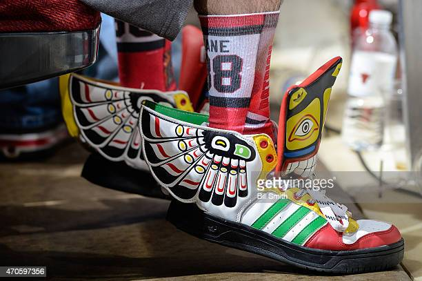 A fan wears custom made Chicago Blackhawks shoes during Game Four of the Western Conference Quarterfinals against the Nashville Predators during the...