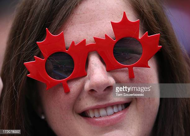 A fan wears sunglasses with the Canadian maple leaf during Canada Day during the Toronto Blue Jays MLB game against the Detroit Tigers on July 1 2013...