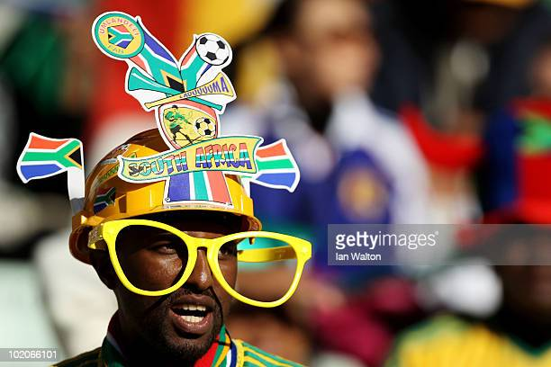 A fan weas a Makarapa helmet during the 2010 FIFA World Cup South Africa Group E match between Japan and Cameroon at the Free State Stadium on June...