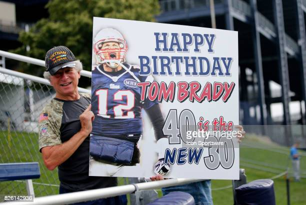 A fan with a birthday sign on New England Patriots quarterback Tom Brady's 40th birthday during Patriots training camp on August 3 at Gillette...