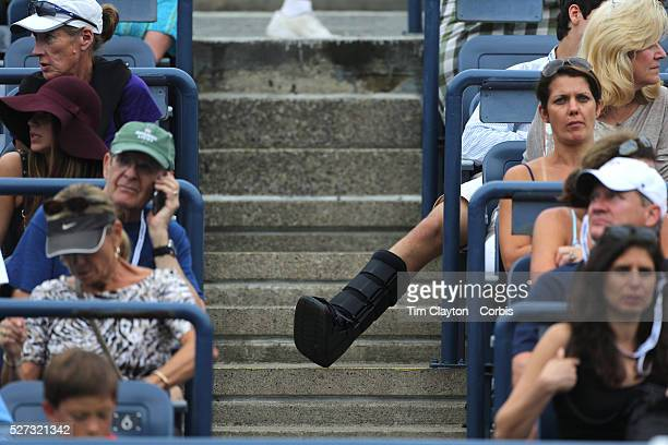 A fan with a leg injury watching Venus Williams USA in action against Jie Zheng China during the Women's Singles competition at the US Open Flushing...