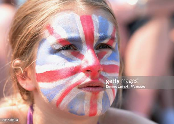 A fan with a painted face on Murray Mount as they watch Great Britain's Andy Murray play Serbia's Novak Djokovic in their Men's Final on the big...