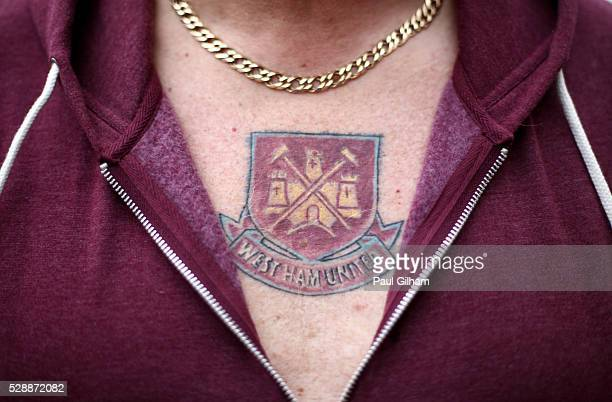 A fan with West Ham United emblem tattoo on his chest is seen prior to the Barclays Premier League match between West Ham United and Swansea City at...