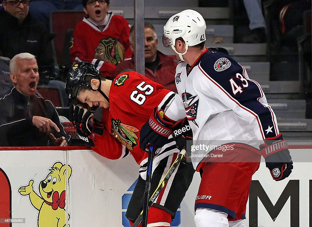 A fan yells as <a gi-track='captionPersonalityLinkClicked' href=/galleries/search?phrase=Andrew+Shaw+-+Eishockeyspieler&family=editorial&specificpeople=10568695 ng-click='$event.stopPropagation()'>Andrew Shaw</a> #65 of the Chicago Blackhawks reacts after being hit by <a gi-track='captionPersonalityLinkClicked' href=/galleries/search?phrase=Scott+Hartnell&family=editorial&specificpeople=201889 ng-click='$event.stopPropagation()'>Scott Hartnell</a> #43 of the Columbus Blue Jackets at the United Center on March 27, 2015 in Chicago, Illinois. The Blue Jackets defeated the Blackhawks 5-2.
