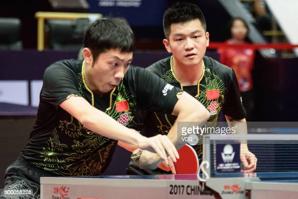 Fan Zhendong and Xu Xin of China compete during the men's doubles first round match against Kim Minseok and Lim Jonghoon of Korea on the day one of...
