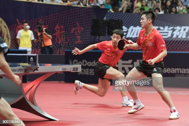 Fan Zhendong and Xu Xin of China compete during the men's doubles semifinal match against Tomokazu Harimoto and Yuto Kizukuri of Japan on the day two...