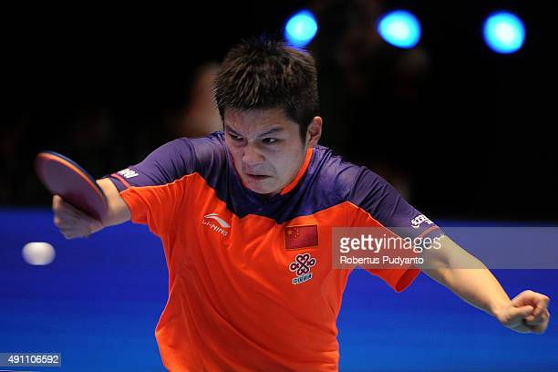 Fan Zhendong of China competes against Xu Xin of China during Men's singles final match of the 22nd 2015 ITTF Asian Table Tennis Championships at...