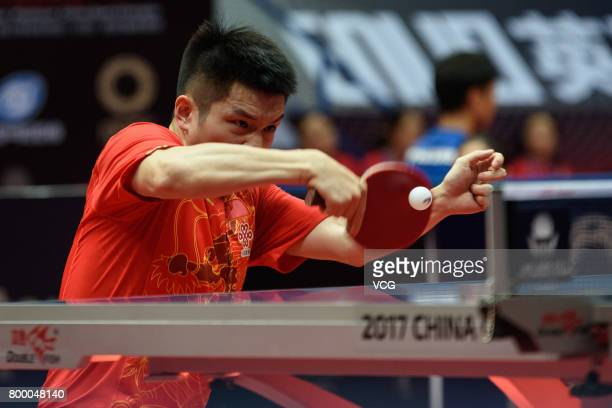 Fan Zhendong of China competes during the men's singles first round match against Asuka Machi of Japan on the day one of the 2017 ITTF World Tour...