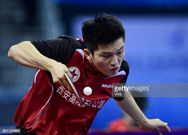 Fan Zhendong of China competes in the Men's Team second stage matches of the 13th Chinese National Games at Wuqing sport center on August 30 2017 in...