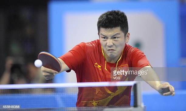 Fan Zhendong of China competes with Yuto Muramatsu of Japan in the Men's Table Tennis Singles final match on day four of the Nanjing 2014 Summer...