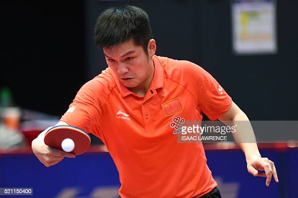 Fan Zhendong of China returns the ball during the men's singles final match against Ma Long of China at the Asian Table Tennis Qualification...