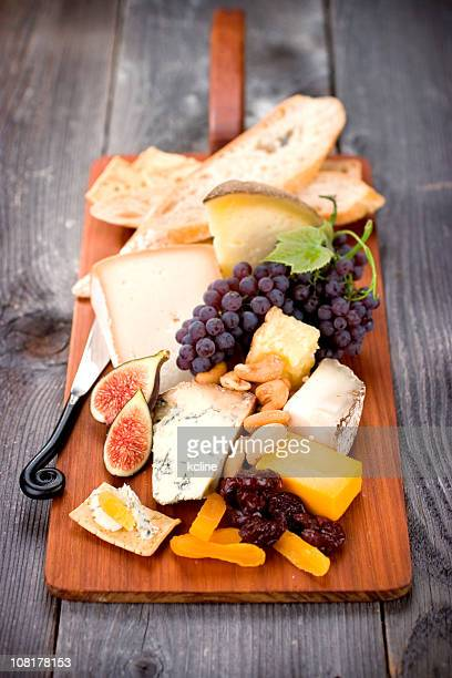 Fancy board of cheeses, figs, and grapes