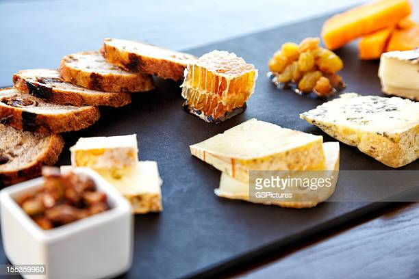 Fancy cheese plate with bread and honey