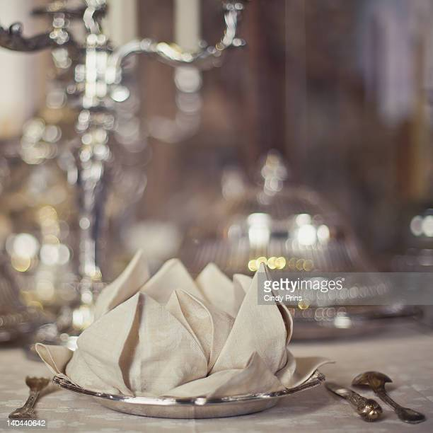 Fancy dinner table with silver and flower napkin
