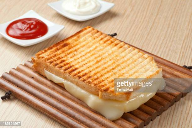 Fancy grilled cheese played with condiments