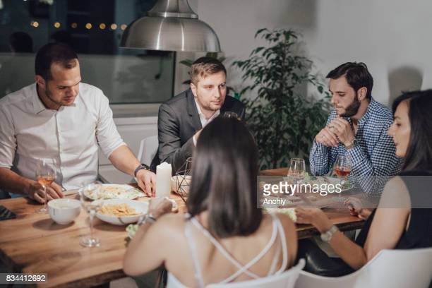 Fancy group of friends eating dinner