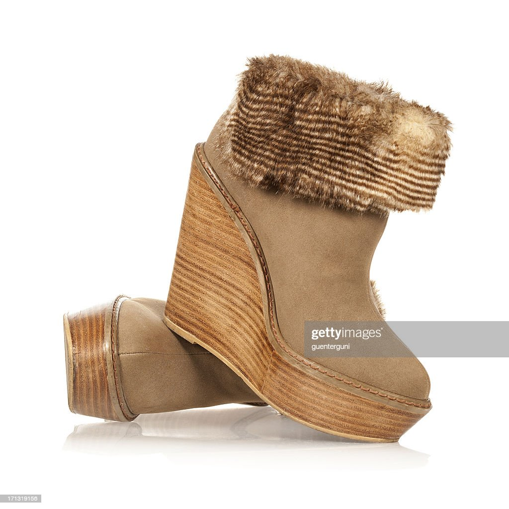 Fancy high heels ankle boots in wedge style