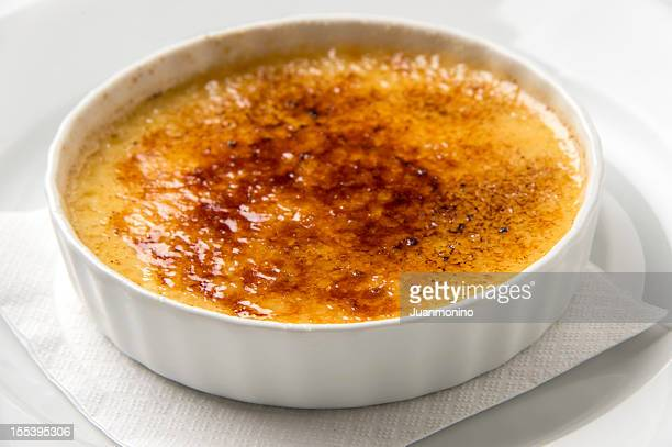 Fancy picture of a crème brulee standing on a napkin