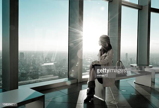 Fancy Woman in Backlight Modern Architecture