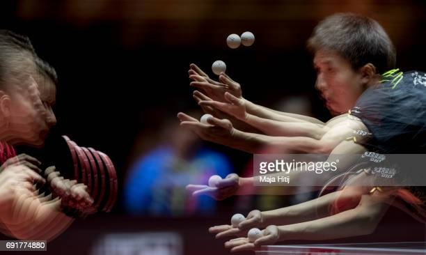 Fang Bo of China and Petrissa Solja of Germany in action during Mixed Doubles Semi Finals at Table Tennis World Championship at Messe Duesseldorf on...