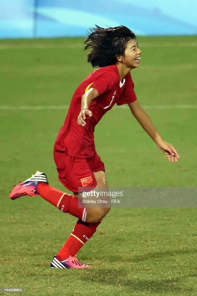 Fang Jie of China celebrates after she converted the winning penalty in the penalty shoot out after the full time scoreless draw during the 2014 FIFA Girls Summer Youth Olympic Football Tournament Semi Final match between China and Slovkia at Wutaishan Stadium on August 23, 2014 in Nanjing, China.