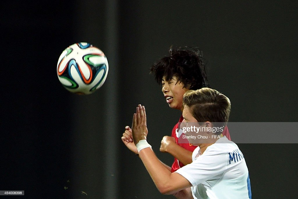 Fang Jie of China clashes with Martina Surnovska of Slovakia during the 2014 FIFA Girls Summer Youth Olympic Football Tournament Semi Final match between China and Slovakia at Wutaishan Stadium on August 23, 2014 in Nanjing, China.