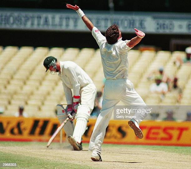 Fanie de Villiers of South Africa celebrates an historic win after taking the wicket of Glenn McGrath of Australia during the Second Test match...