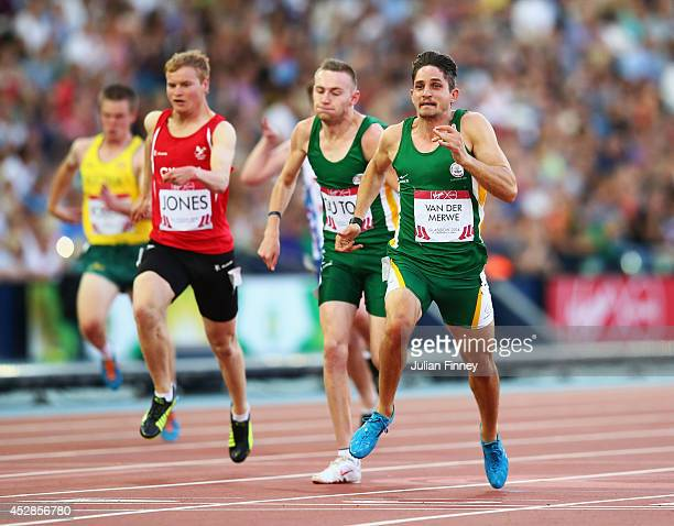 Fanie van der Merwe of South Africa crosses the line to win gold ahead of silver medalist Charl du Toit of South Africa and bronze medalist Rhys...