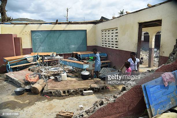 TOPSHOT Fanita and her daughter Gasna stay in class room destroyed during Hurricane Matthew in the National school of Labeyu in the commune of...