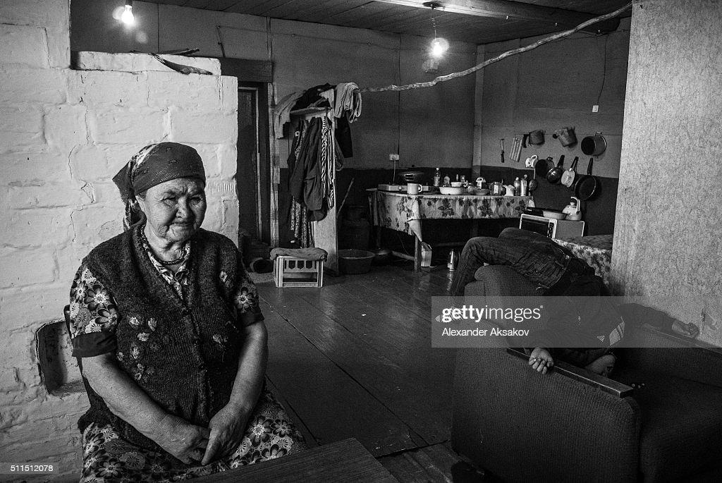REGION, SIBERIA, RUSSIA - OCTOBER 10, 2015: Faniya and her grandson ...