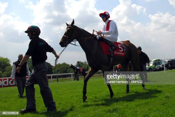 Fann ridden by Richard Hughes going to post in the Princess Elizabeth Stakes