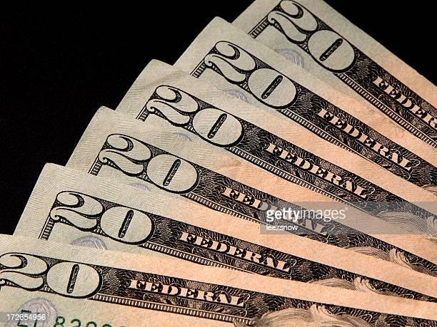 Fanned US $20 Bills On Black