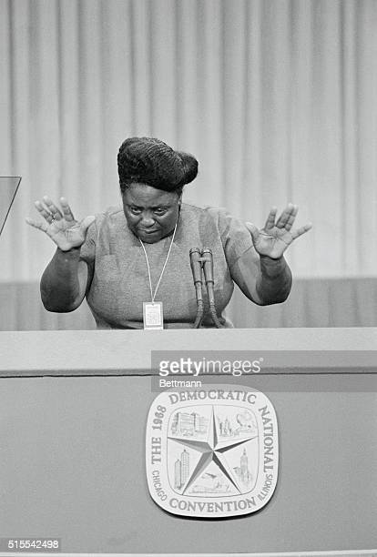 Fannie Lou Hamer of Mississippi gestures with her hands as she speaks from the rostrum here addressing the delegates on the fight over Alabama...