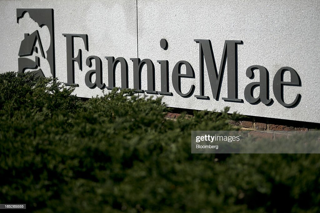 Fannie Mae signage is displayed outside of the company's headquarters in Washington, D.C., U.S., on Tuesday, April 2, 2013. Fannie Mae, the mortgage financier seized by U.S. regulators during the credit crisis, reported the largest annual profit in company history as a housing rebound helped the firm stop drawing federal aid. Photographer: Andrew Harrer/Bloomberg via Getty Images